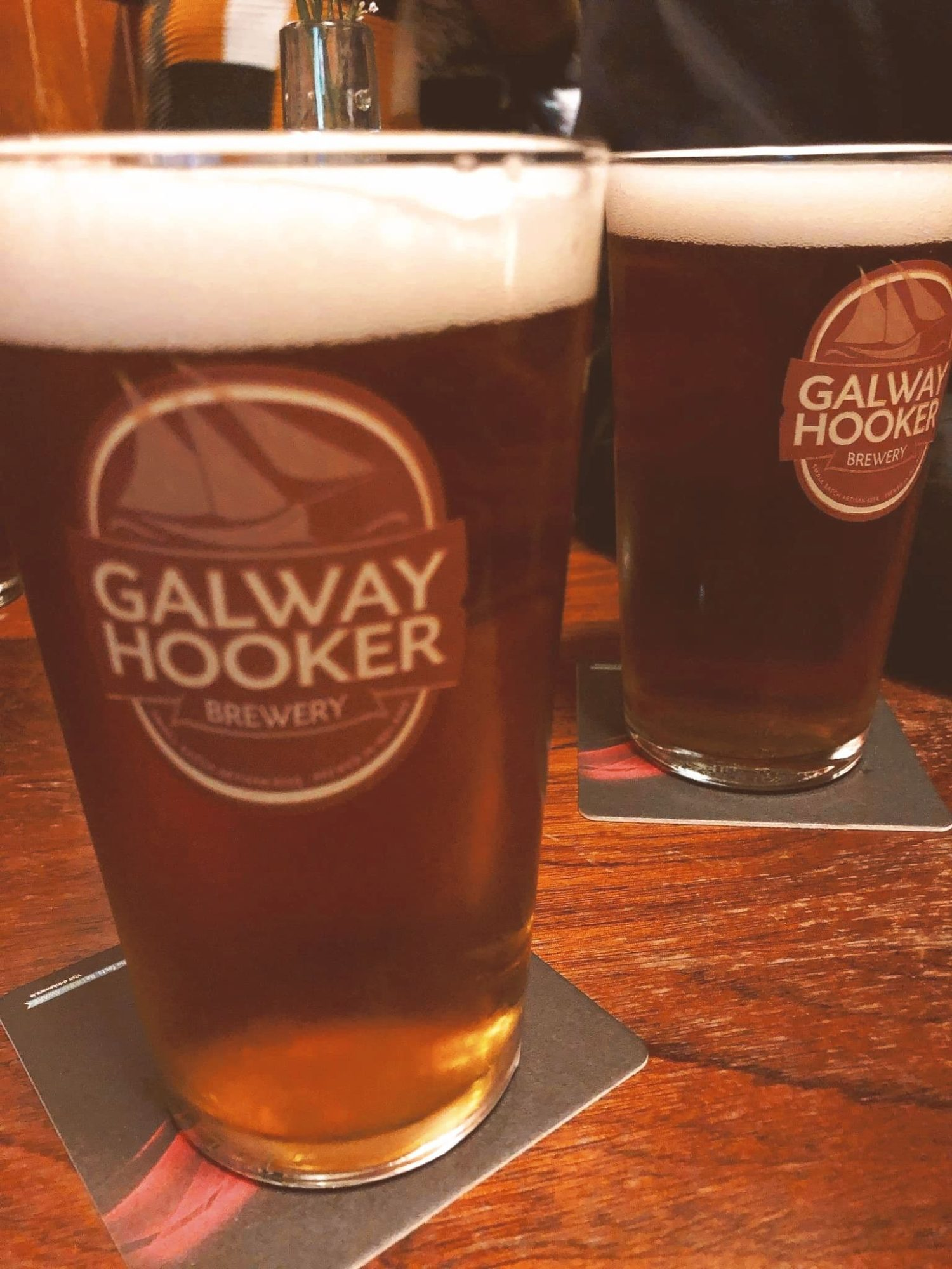 Two Galway Hookers (beers) on a table in an Irish pub..