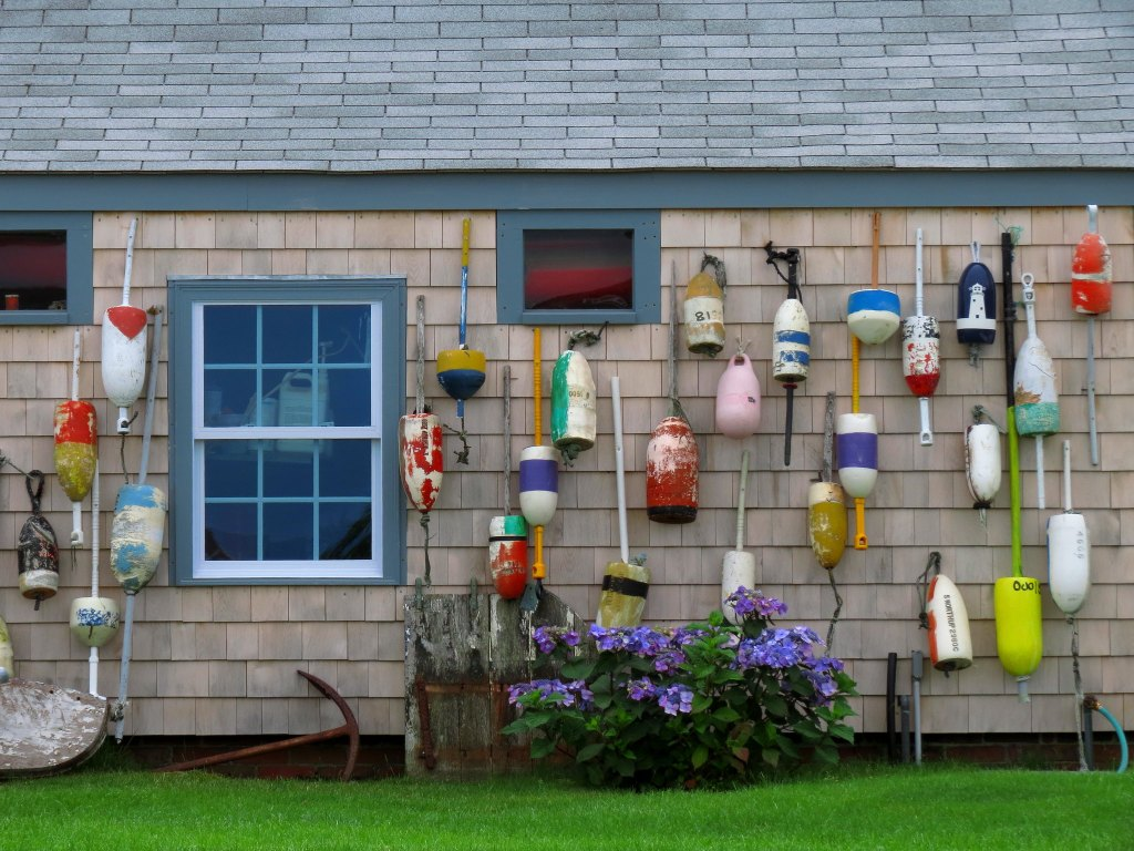 House in Nantucket adorned with multi-colored buoys.