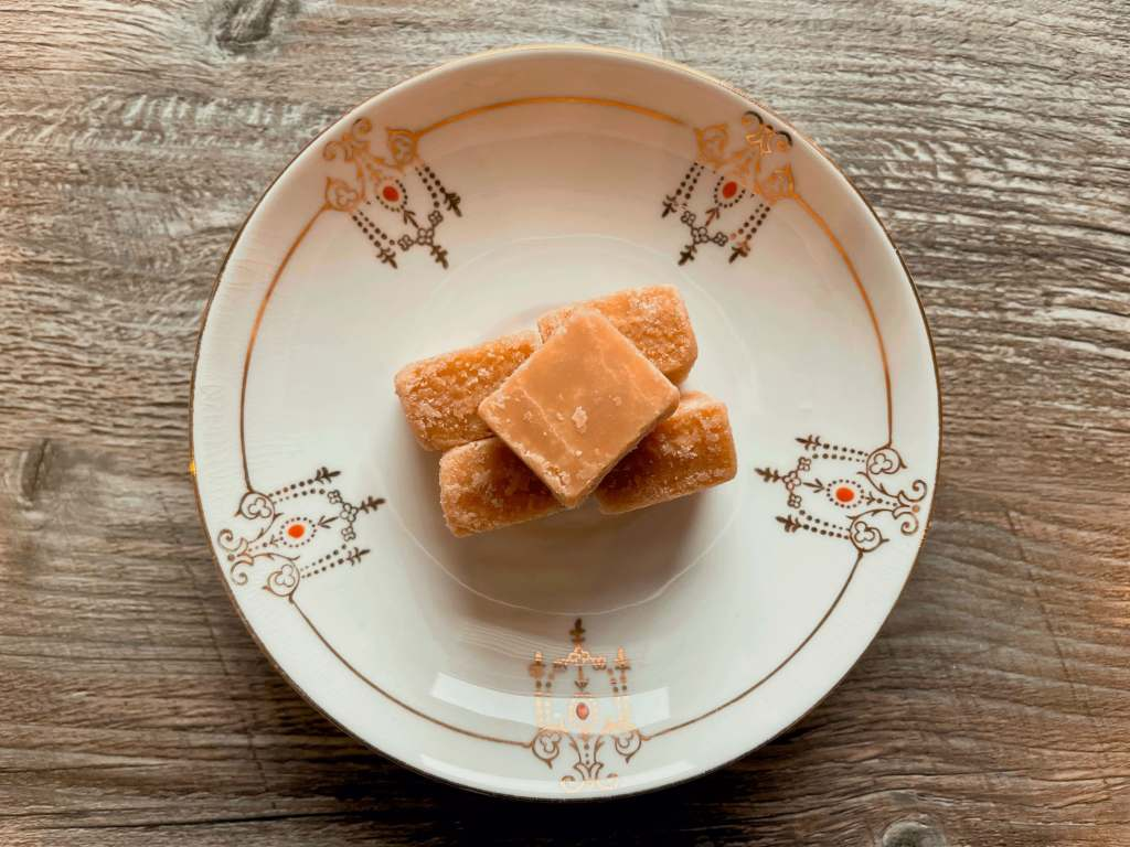 Plate of Scottish Tablet on a wooden table, a popular candy from Scotland.