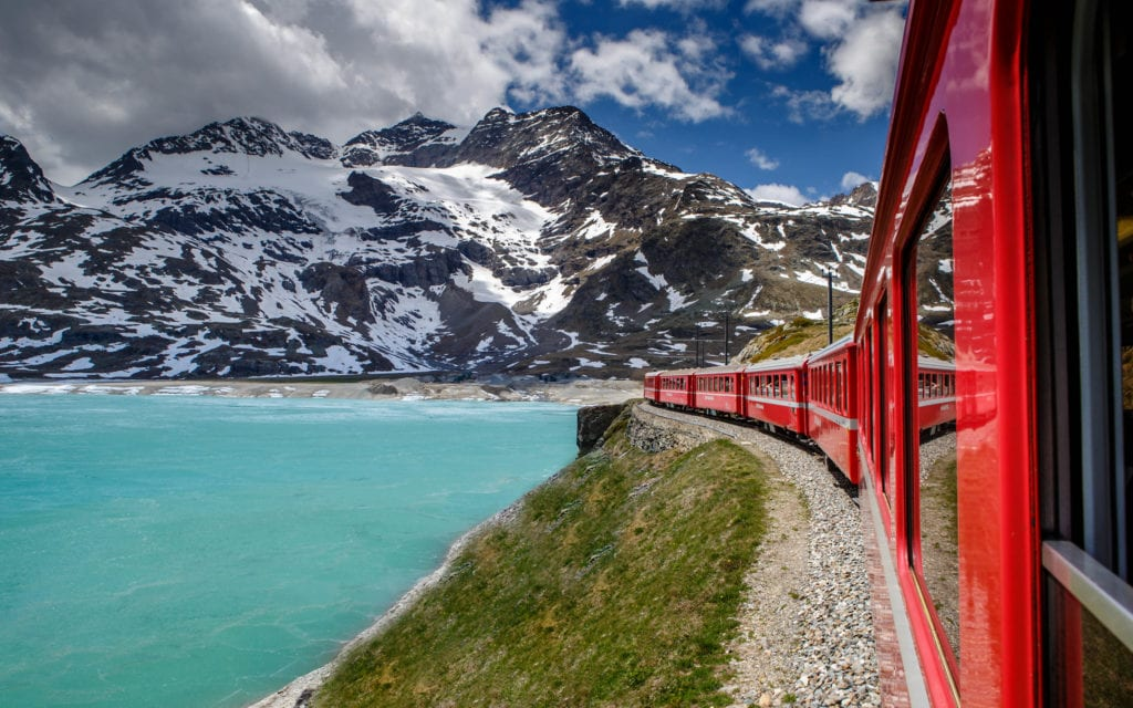 Bernina Express passing by turquoise lake