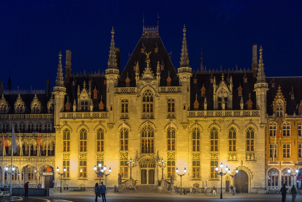 Bruges City Hall at night, illuminated from street lights.  One of the most-visited historic landmarks in Bruges.