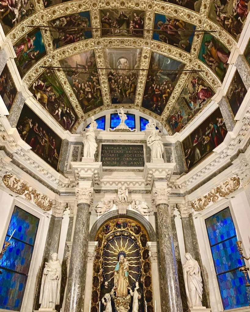 Interior of the Santa Corona Church in Vicenza, Italy with blue and green frescoes on the ceiling  in ornate detail.