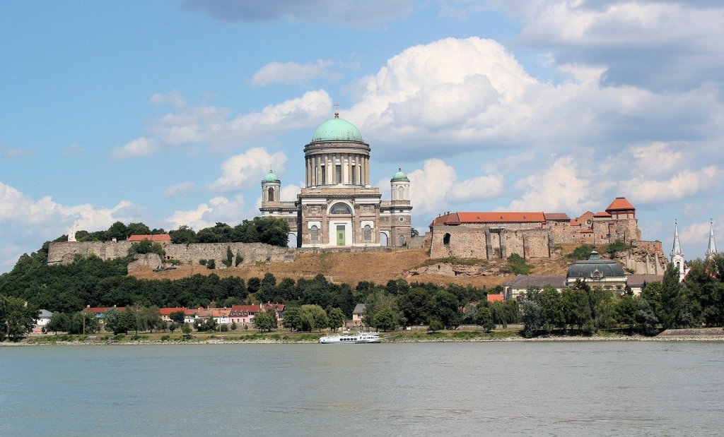 Basilica in Esztergom, Hungary seen from across the lake, one of the best day trips from Budapest.