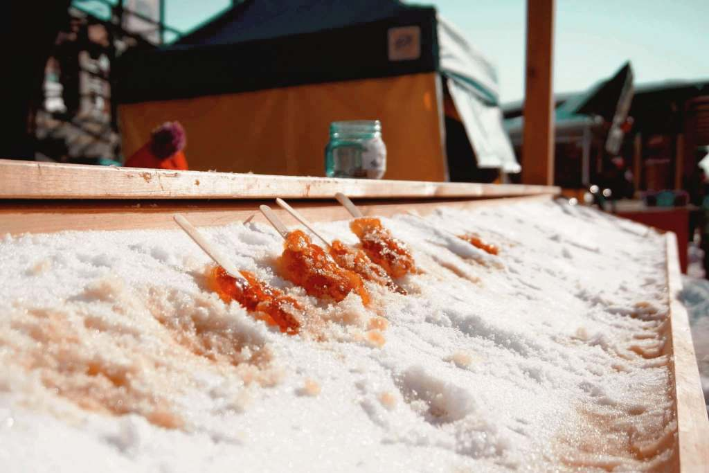 Maple snow taffy being made in the snow in Canada.