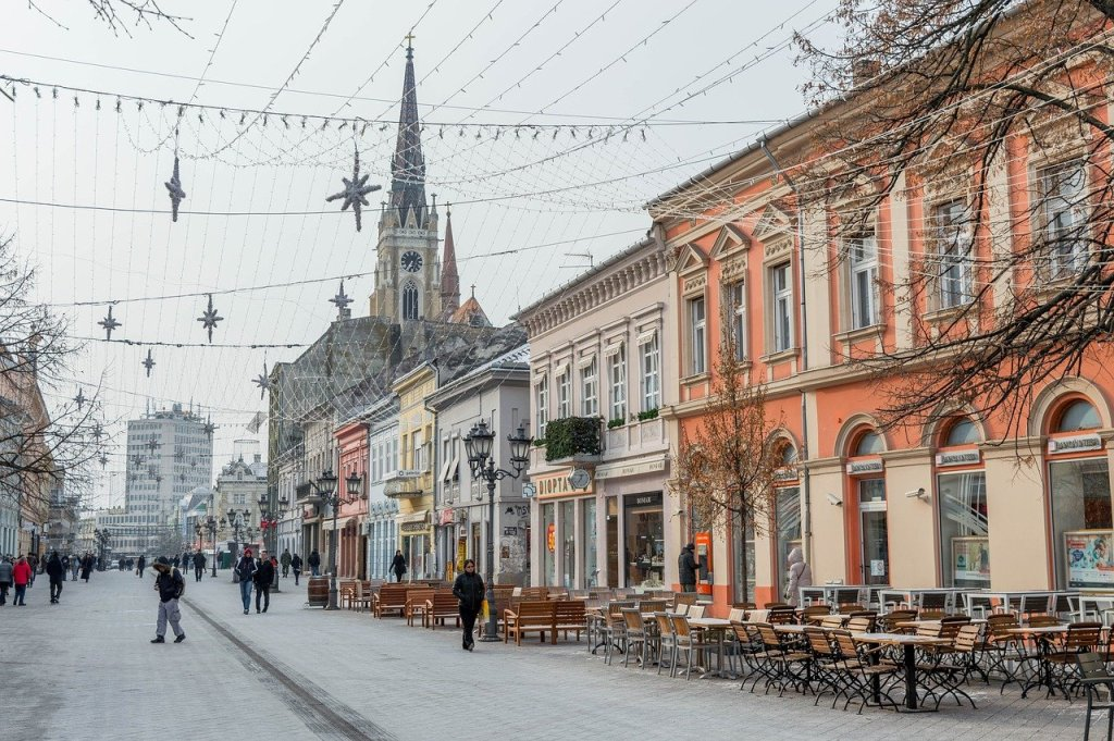 Street in Novi Sad, Serbia in winter with tables and chairs along the street - a great day trip from Budapest.