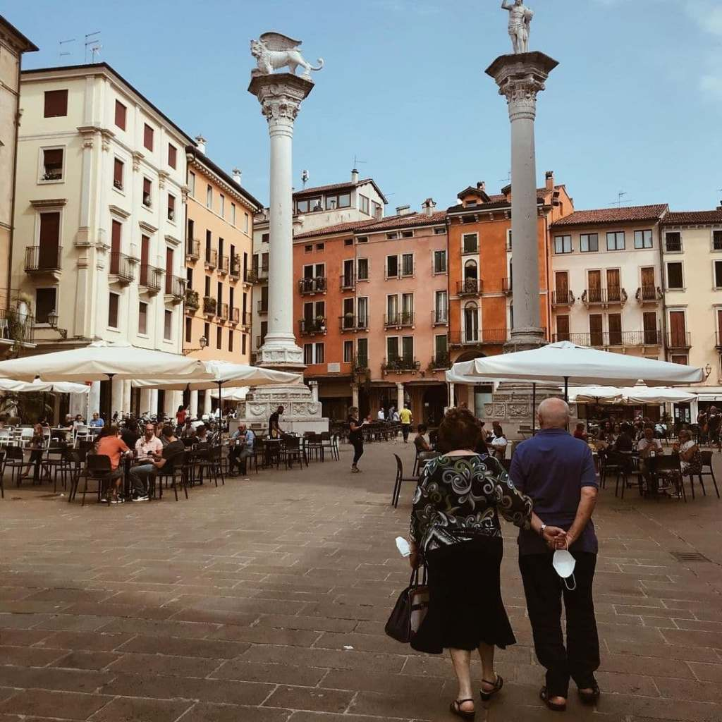 Older couple walking through Piazza dei Signori, one of the best things to do in Vicenza.