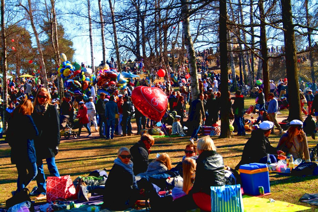 Many people gathered for picnic in a park during Finland's annual spring celebration Vappu.