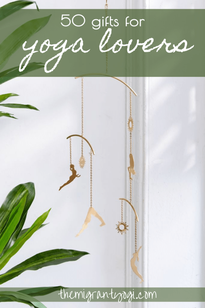 Pinterest graphic depicting gold metal cutouts of yoga poses on a mobile with text: 50 Gifts for Yoga Lovers