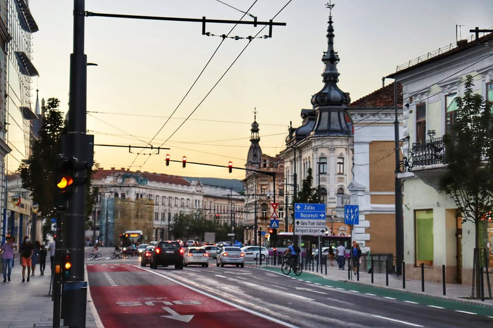 Picture of city streets in Cluj-Napoca, Romania during sunset.