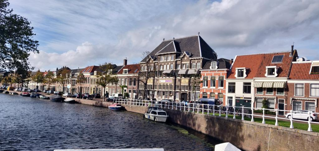 Haarlem in the Netherlands with small boats docked on the edge of the river