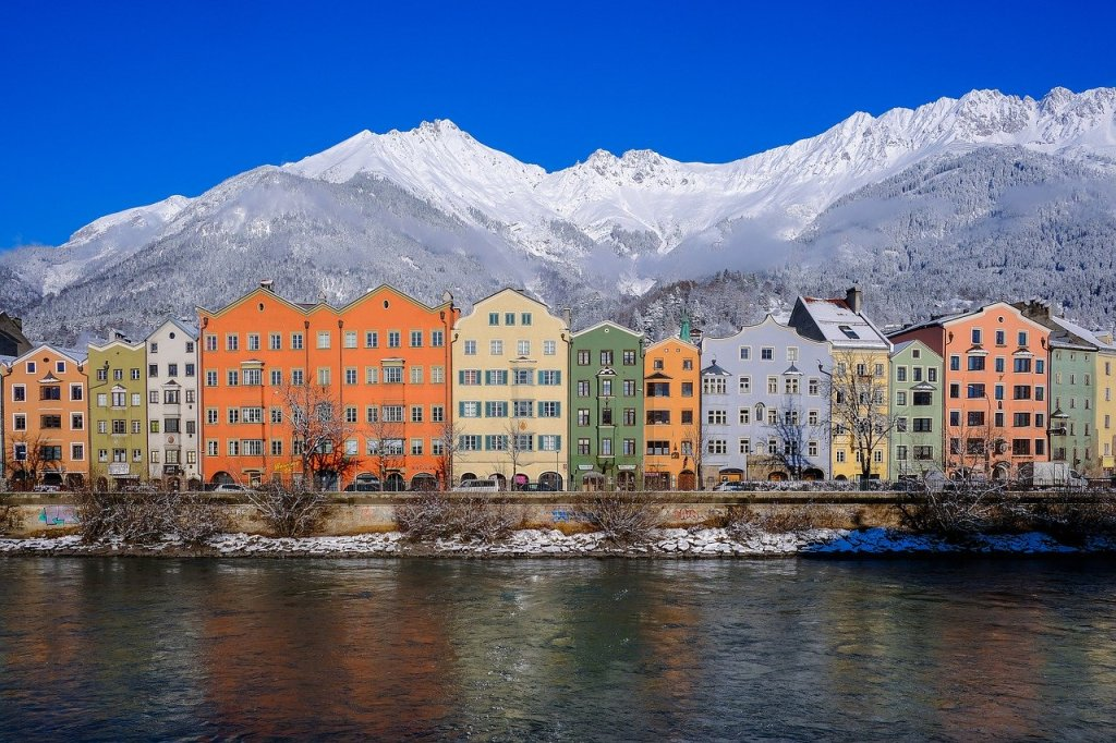 Colored buildings in front of the Austrian Alps in Innsbruck, Austria.