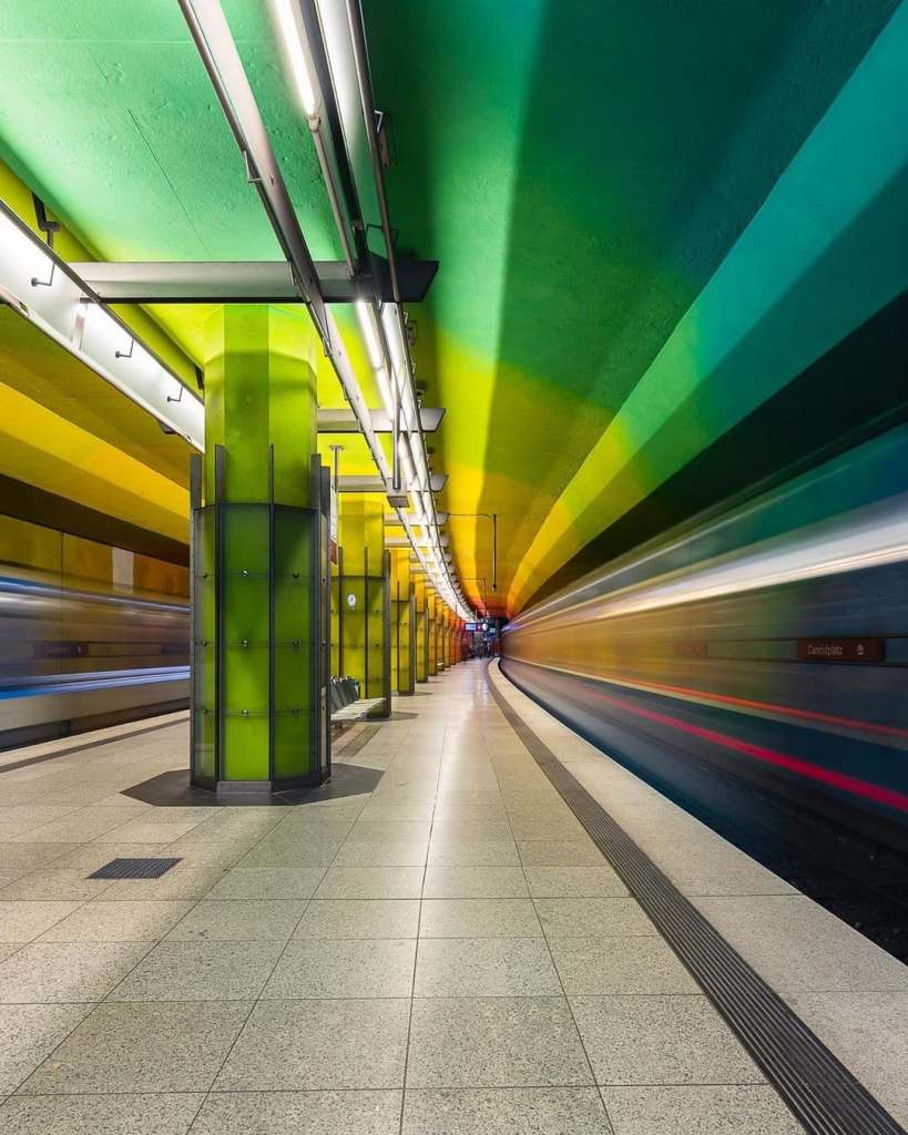 Rainbow colors flashing through a subway station in Munich, Germany.