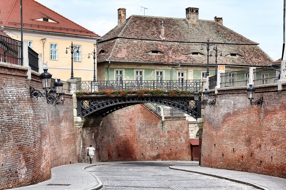 Woman walking under the Bridge of Lies in Sibiu, Romania during the lockdown