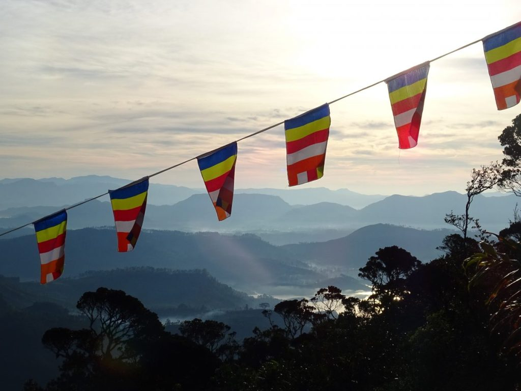 Sri Lankan flags hanging against a mountain backdrop.