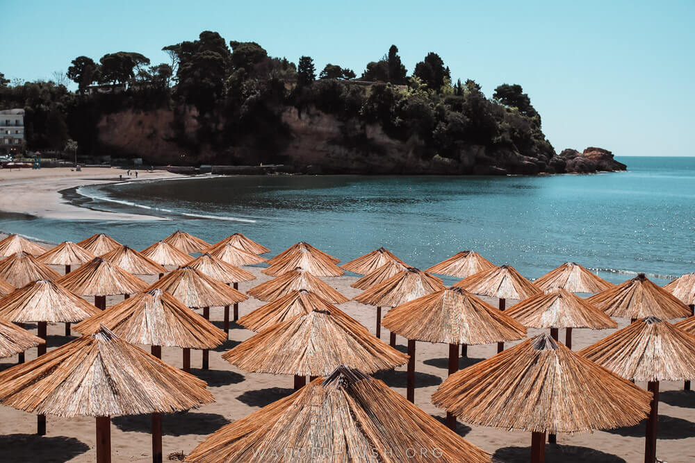 Beachfront in Montenegro with many umbrellas.  Located in Ulcinj, it is an underrated beach destination in Europe.