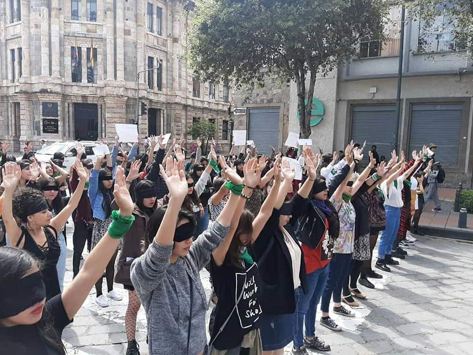 Hundreds of women gather in Cuenca to protest femicide 'el violador eres tu'