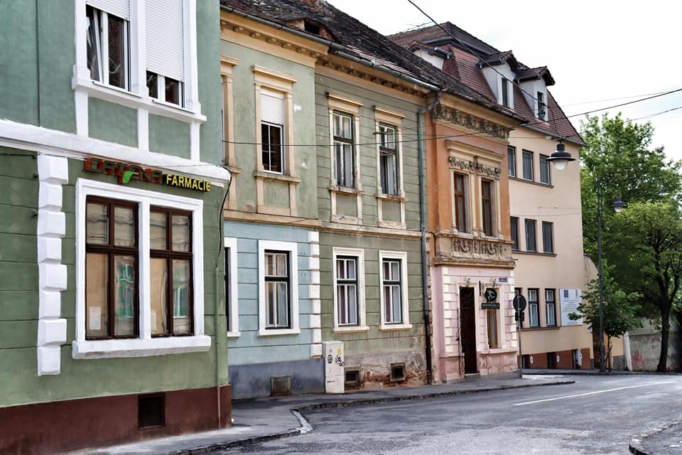 Empty street with colorful buildings in Sibiu, Romania