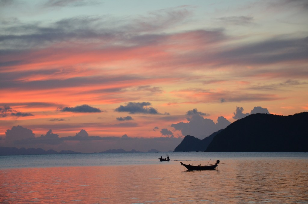 Sunset over water in Koh Phangan, Thailand, a great yoga destination.