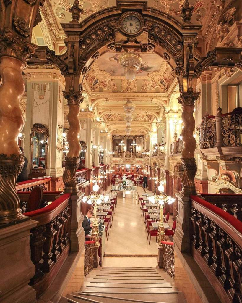 Inside of the opulent New York Cafe