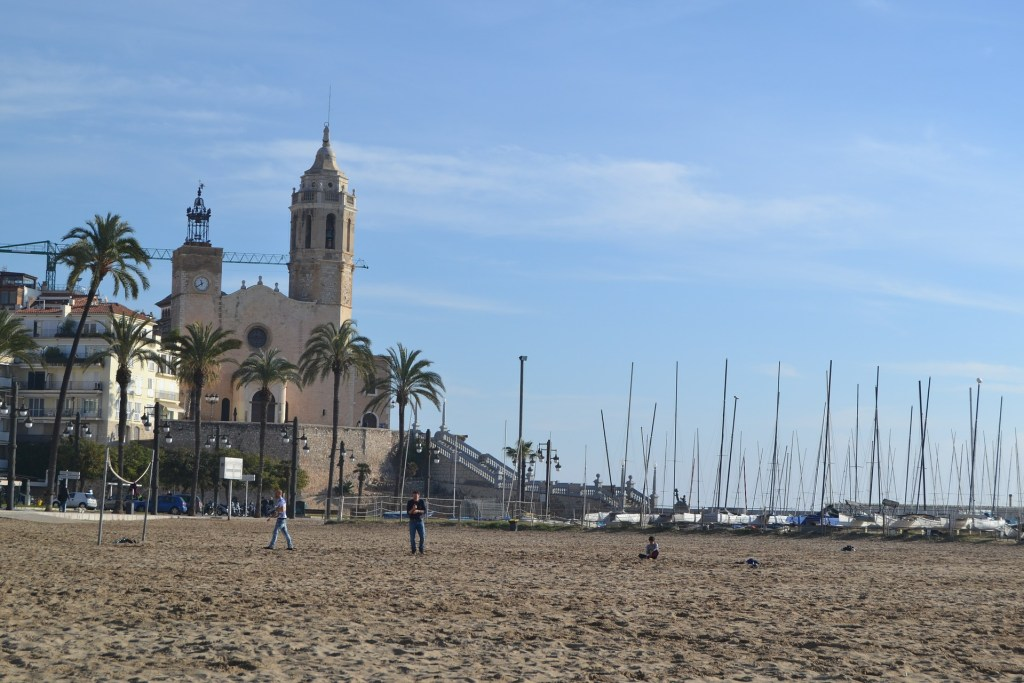 Sandy beach in Sitges, Spain, a great day trip from Barcelona.