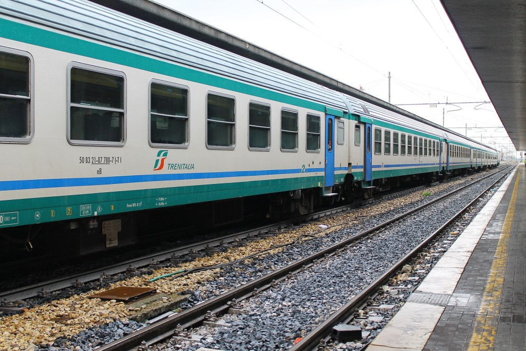 Trenitalia train shown on the tracks in Italy.