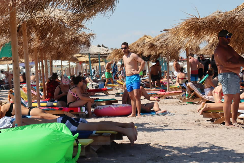Many people crowded on a beach in Vama Veche, Romania