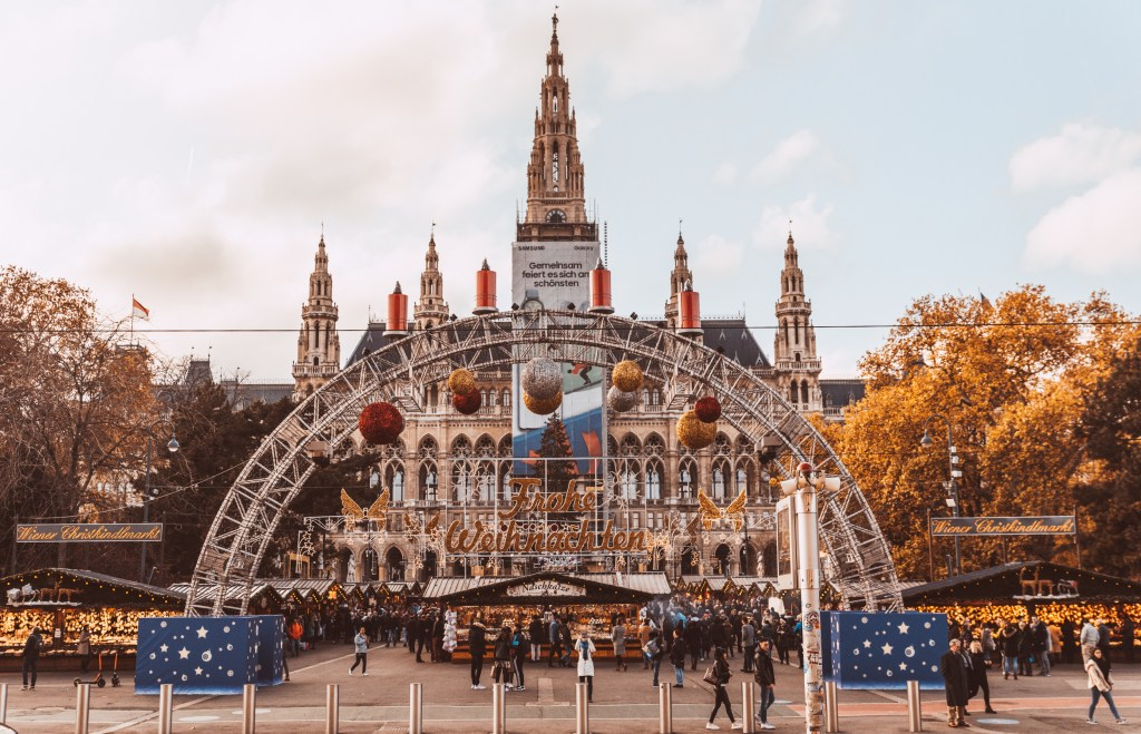 The main entrance to Vienna's annual Christmas market, with people walking by during the day.