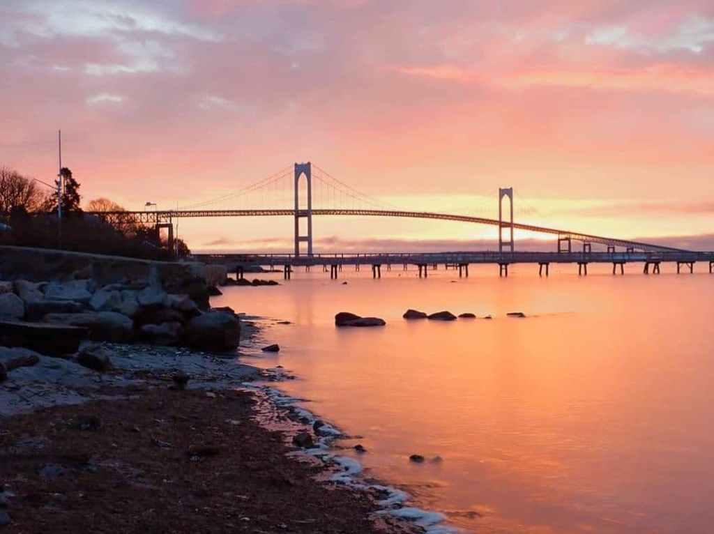 sunset over the newport bridge in rhode island