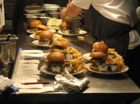 The kitchen staff at Holeman & Finch in Atlanta, Georgia, prepares hot and juicy burgers (not on the menu!) at 10 p.m.