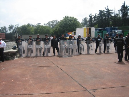 Riot police guard the Chivas fans' entrance at Estadio Olímpico, during the Pumas/Chivas game on Sept. 27, 2009