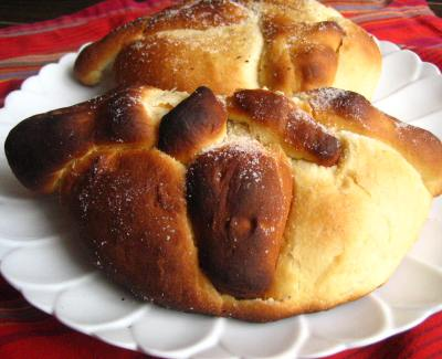 My two pan de muerto loaves (one half-eaten), made at the Universidad Iberoamericana in Mexico City