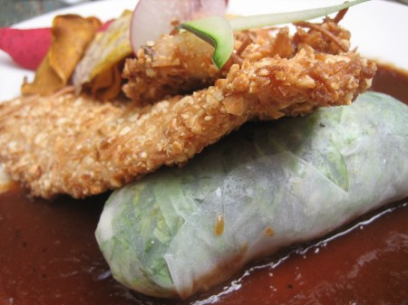 Joy's almond-crusted trout, served in tamarind sauce with a spring roll