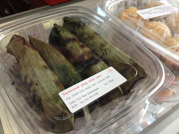 Kaokneaw ping with taro, one of the prepared foods available for sale at Inthira Thai Market in Queens.