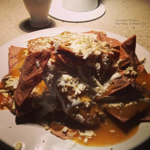 A noir-ish plate of chilaquiles rojos, from Café Zena in San Miguel Chapultepec, Mexico City.