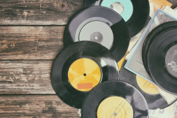 close up image of old records over wooden background , image is