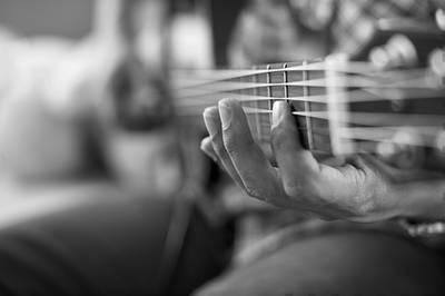 Man playing guitar - The Key Turned fiction