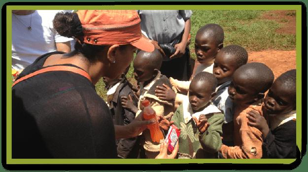 Lidiya with children in Uganda