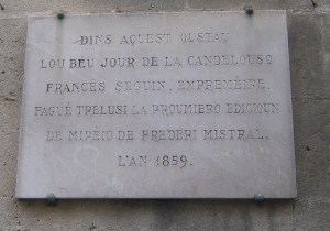 Sign in Avignon showing where Mistral's Mirèio was first published