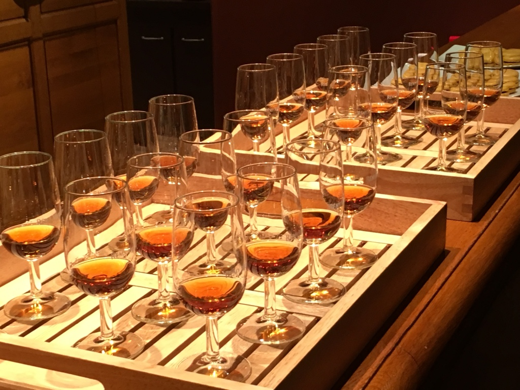 Glasses filled with cognac at the tasting room at Remy Martin Cellar, Cognac, France.