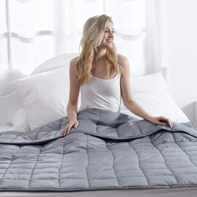 A weighted blanket could help your child calm down and sleep better and combined with additional therapies, Check out this Essential Guide.  #autismparenting #specialneedsparenting #weightedblankets