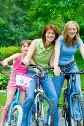 Girls and mother on bikes