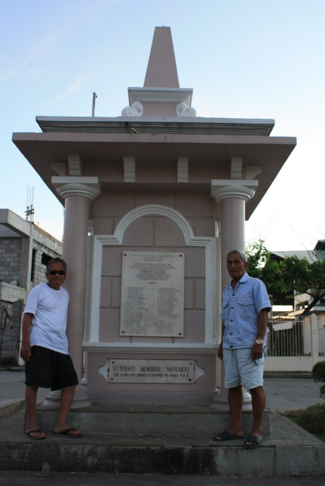 My Grandpa and his friend - World War II veterans standing by the war memorial in the town square
