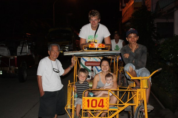 "Family shot on a ""Put Put"" - local method of getting around the town! My Grandpa photobombed #languagebarriers LOL - Isabel, Leyte - 2009"