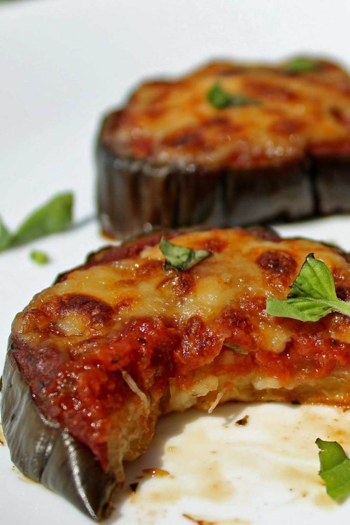 Julia Child's eggplant pizzas are low-carb and gluten-free, made using eggplant slices in place of traditional pizza crust. The eggplant slices are topped with warm tomato sauce, piled high with cheese and so good you'll totally forget about pizza crust. | TheMountainKitchen.com