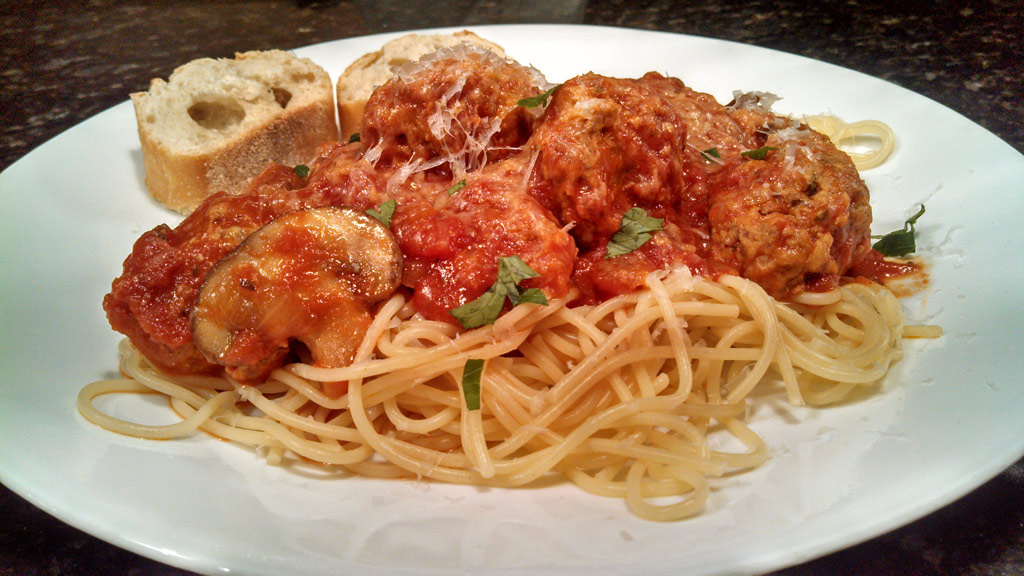 With traditional Italian flavors these mouthwatering meatballs are made with parmesan, Ramona and homemade ricotta cheese. Drenched in simple tomato sauce. | TheMountainKitchen.com