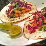 These grilled shrimp tacos have marinated, grilled shrimp on a tortilla, with red cabbage slaw and chipotle sour cream. Reinvent your taco night! | TheMountainKitchen.com