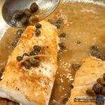 Halibut fillets with a caper butter sauce made of capers, garlic, wine and butter. Make a romantic meal in just 25 minutes. | TheMountainKitchen.com