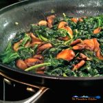 Tender sauteed spinach in butter and olive oil, with fresh mushrooms and green onions is a quick easy and nutritious side dish, ready in just minutes! | TheMountainKitchen.com