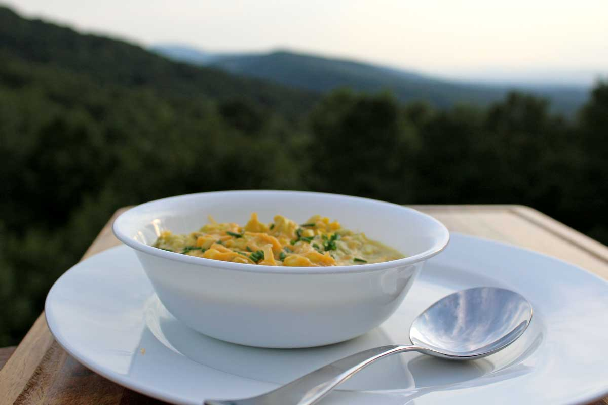summer chowder in bowl with mountain view