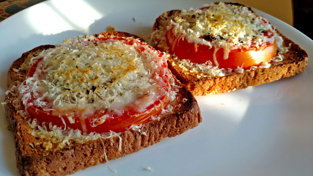 This open-face Caprese Sandwich is perfect for a quick summer meal, toasted bread with tomato slices, basil, mozzarella and parmesan cheese. | TheMountainKitchen.com